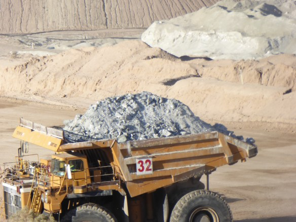 A really large truck filled with ore