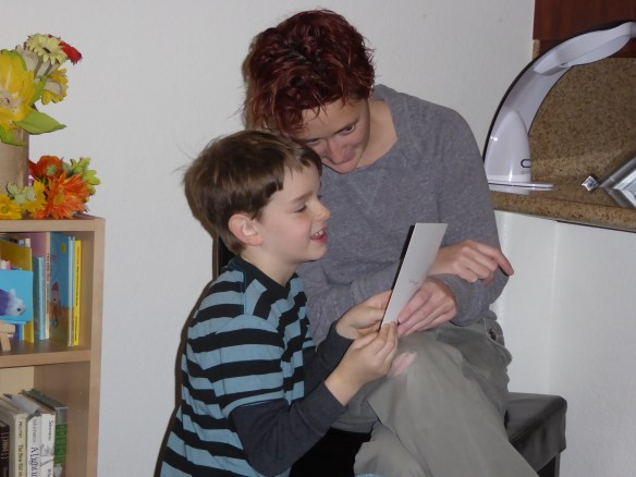 Sam looks at a birthday card with Auntie Leigh