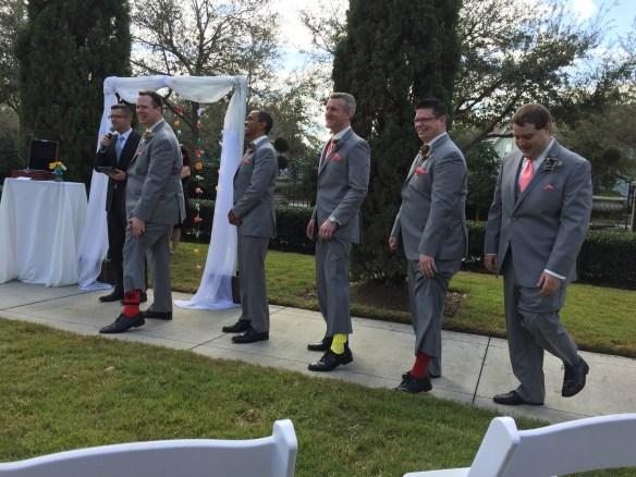 The groomsmen show off their superhero socks
