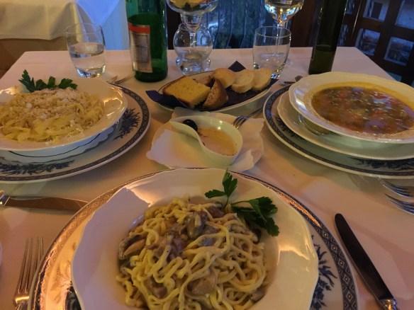 Primi of Cacio e pepe, strangozzi with mushrooms, and minestrone
