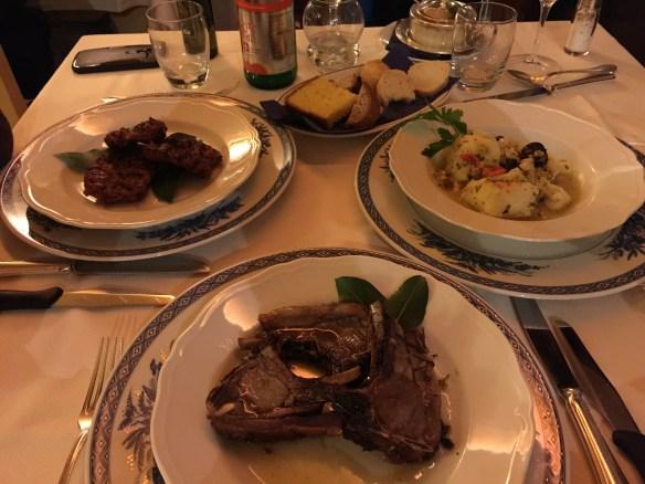 Sausages, lamb chops, and cod