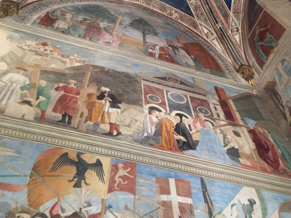 Central panel shows St. Helena identifying the true cross by raising a young man from the dead.