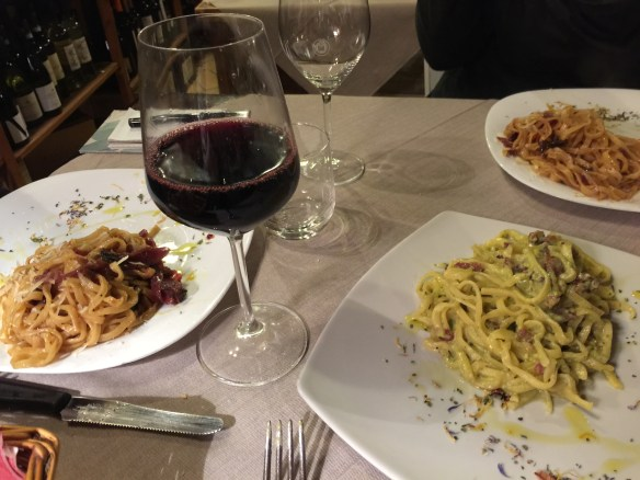 It's pasta night! We have strangozzi with pistachio nuts and wild boar(Mary), with wine and pork jowl (John and Sarah)