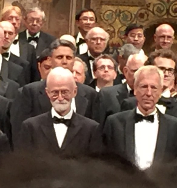 Finally I find Jon peering out among a sea of shoulders and heads