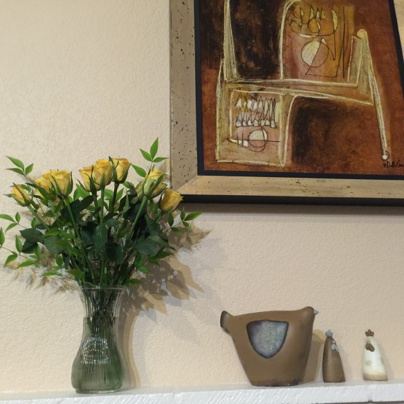 Yellow roses from John on the mantel