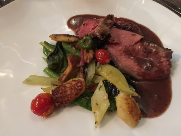 Porterhouse slices with gnocchi and vegetables