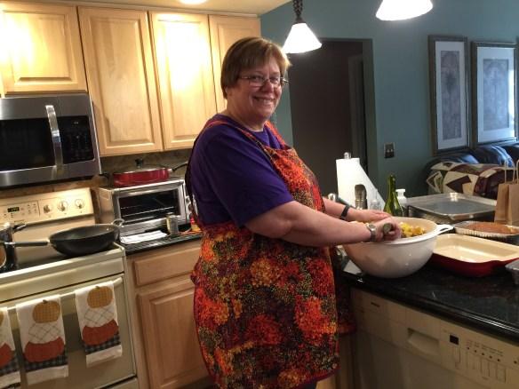 Phyllis wearing her apron hard at work