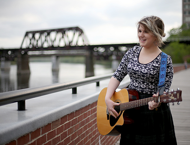 Musician Emma Gallo poses for a photo on the boardwalk along the Merrimack River in Haverhill. Gallo will be performing in this summer's Make Some Noise outdoor music series.