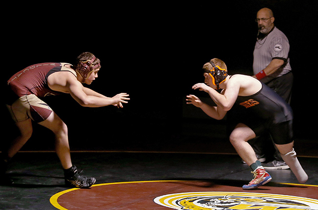 Greater Lawrence Tech wrestler Austin Poirier wrestles Whittier Tech's John Michitson during their meet in Haverhill, Mass.