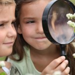 girls with magnifying glass