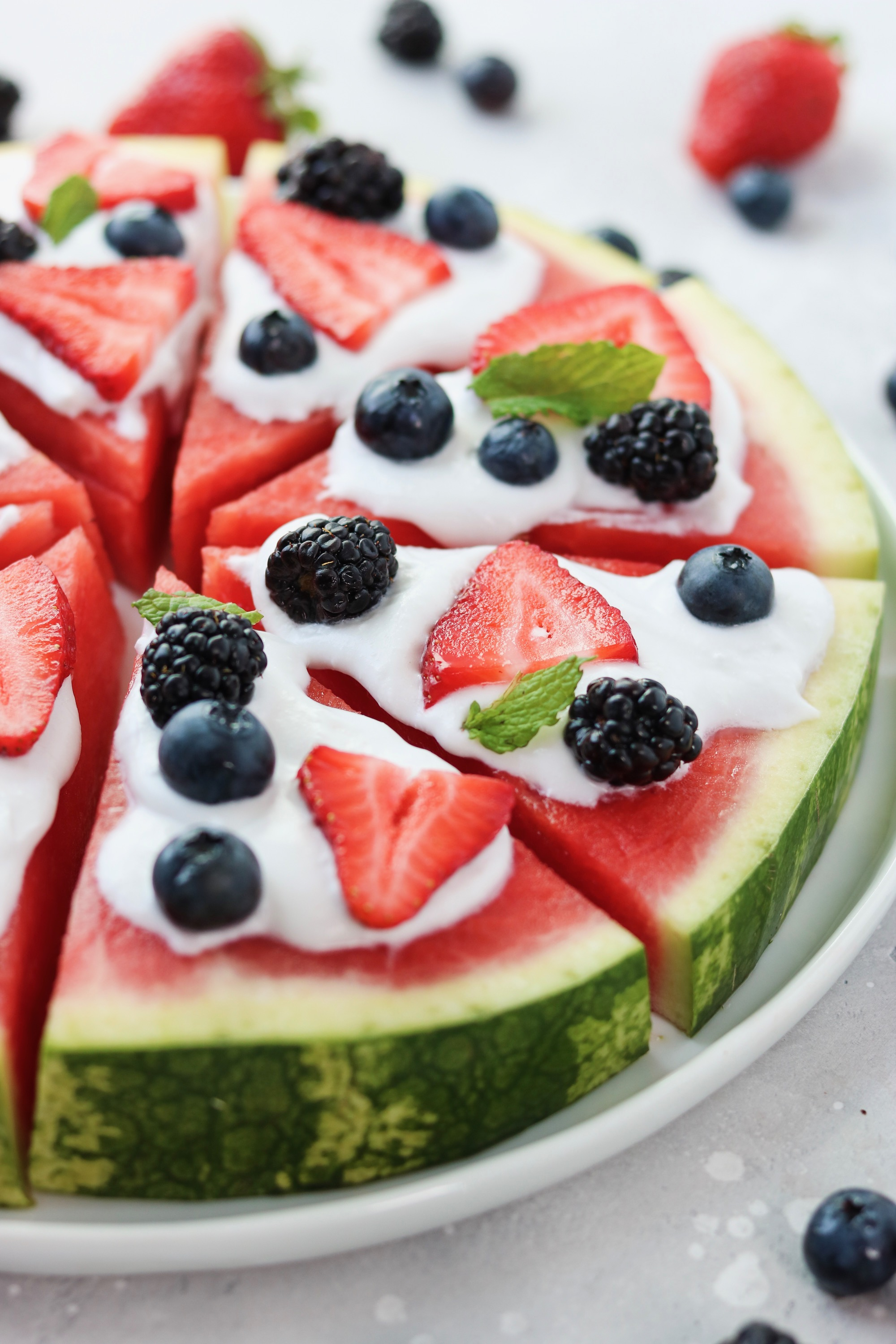 watermelon pizza with homemade whipped coconut cream and fresh berries