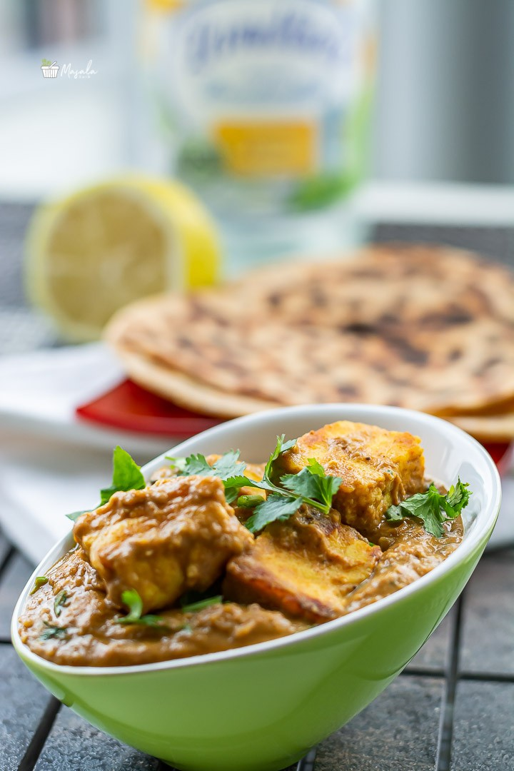Paneer gravy served with parathas.