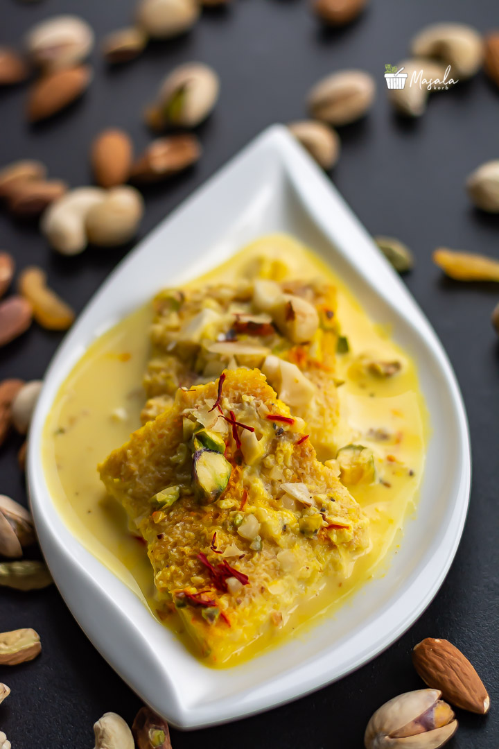 Instant Rasmalai Recipe With Bread Served on a white plate