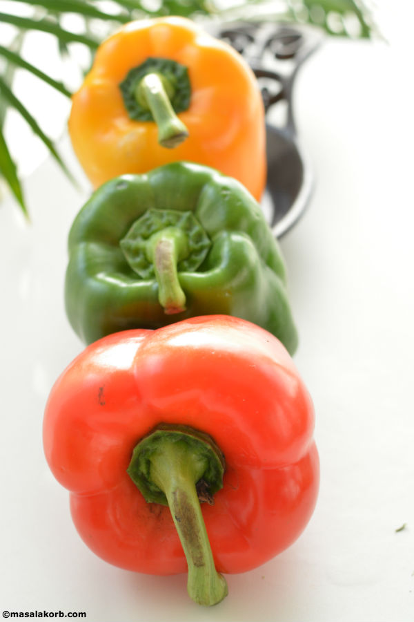 Tricoloured capsicums or bell peppers