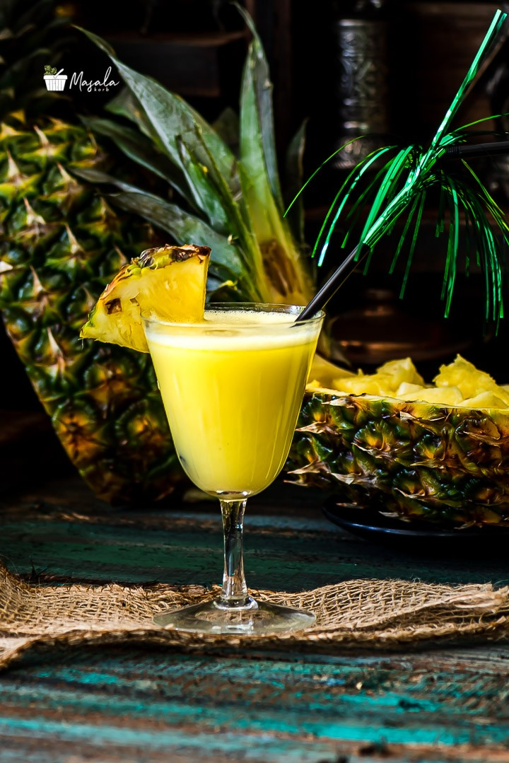 Virgin Pina colada served in a glass with a straw
