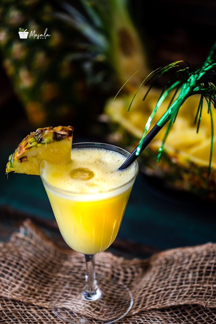 Pina colada served with cut pineapple in the background
