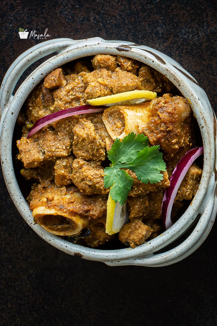 Top angle view of mutton curry