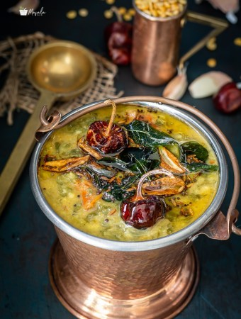 Palakura Pappu Andhra Style served in a copper bucket.