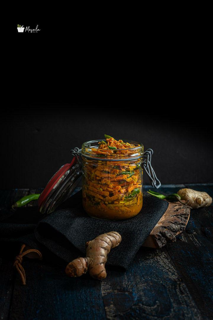 Finish shot of turmeric pickle in a glass jar