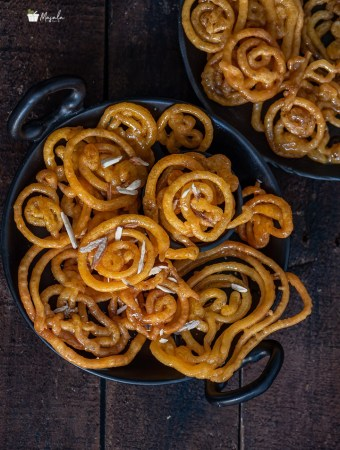 Instant Jalebi Recipe Without Yeast sprinkled with some shaved almonds.