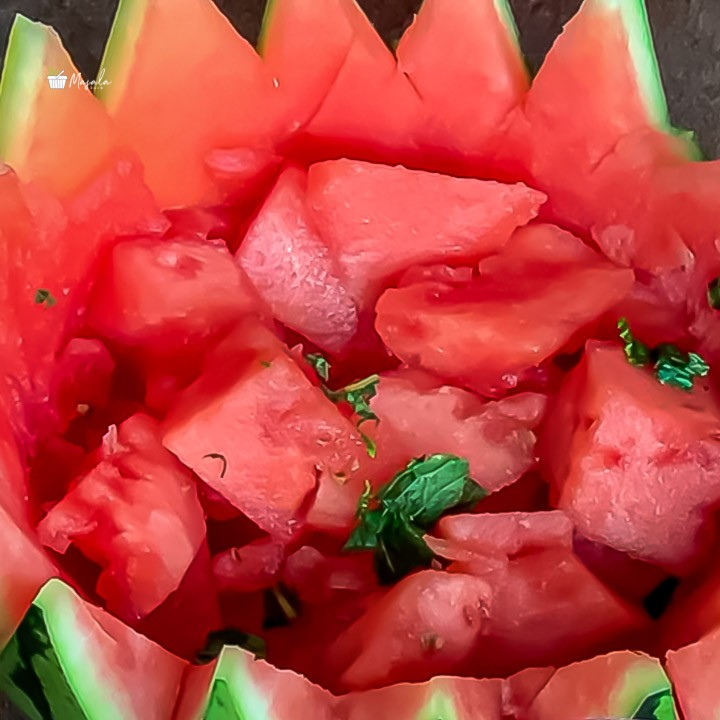Watermelon chaat salad served in watermelon rind carving-Unique Watermelon Recipes
