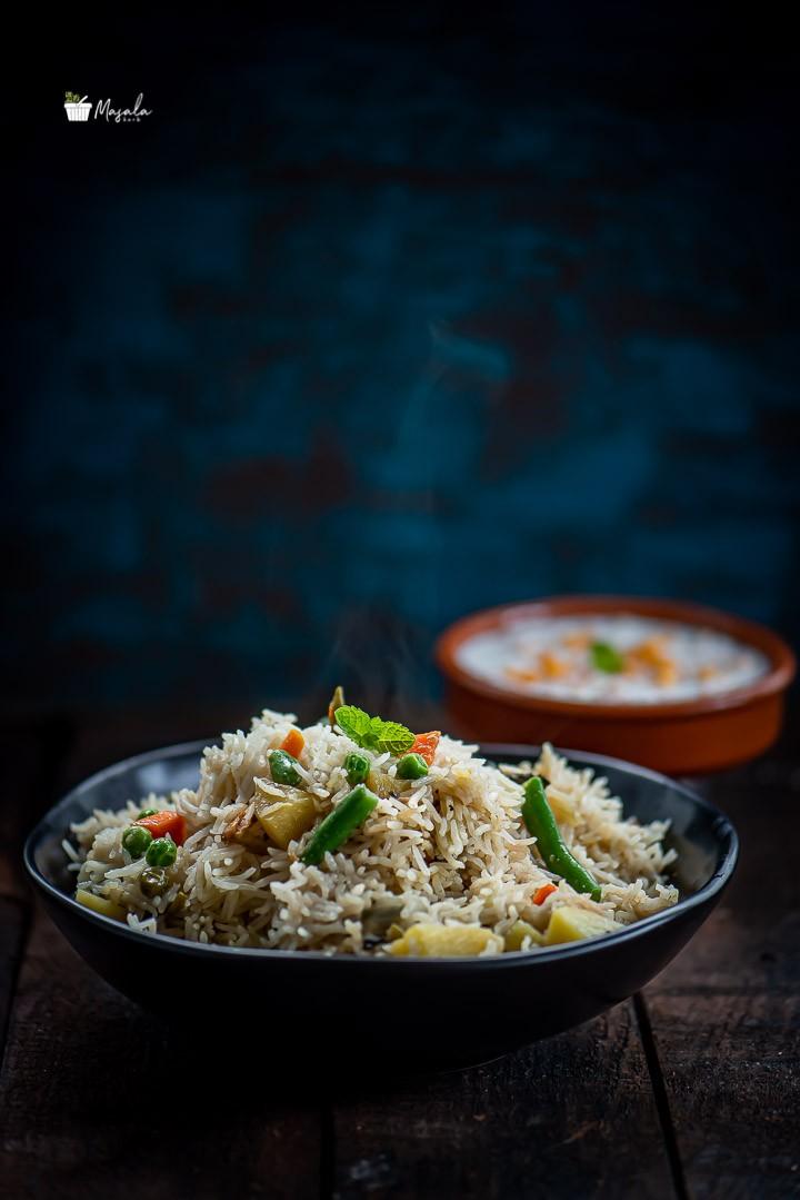 Easy Instant Pot Vegetable Biryani served in a black bowl.