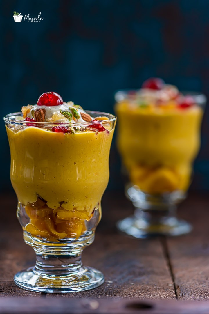 Mango Mastani Served in two tall glasses.