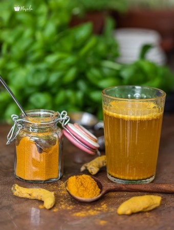 Turmeric tea powder recipe with turmeric tea in a glass