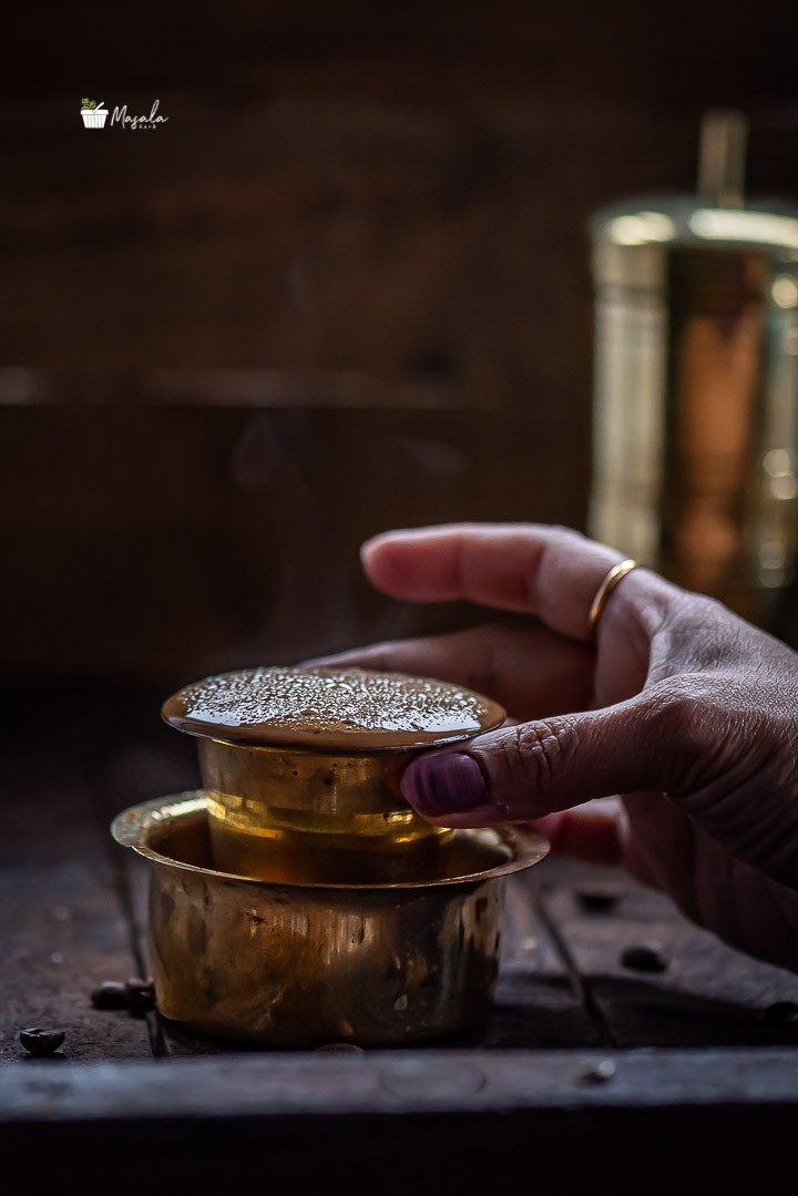 Filter coffee served in a brass dabarah and tumbler
