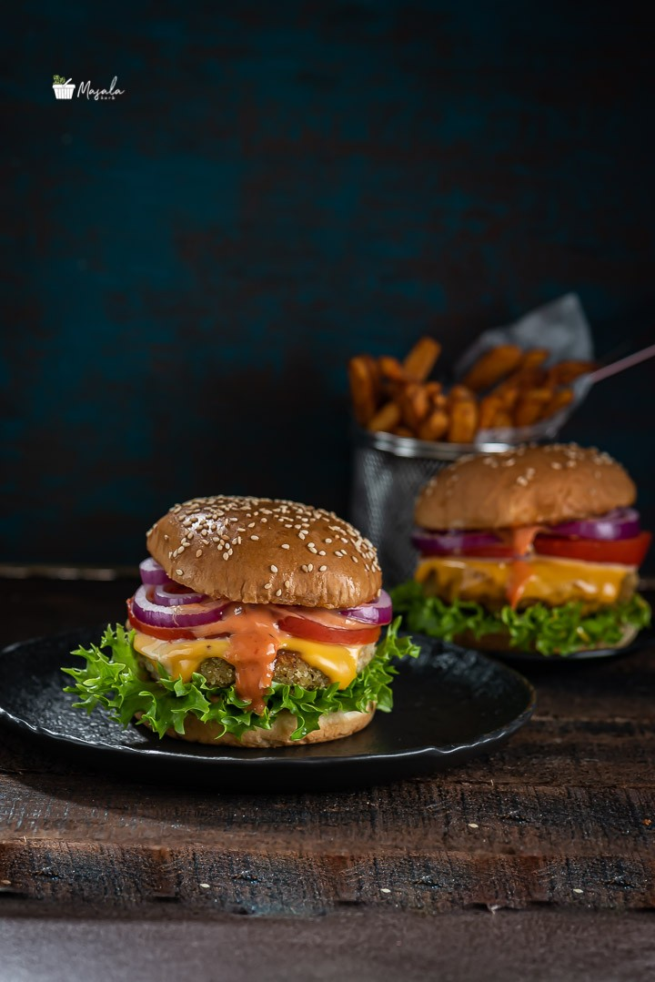 Veggie Burger served with masala french fries.