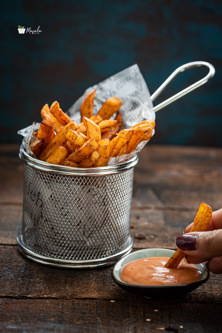 Tasting potato Fries with a dip
