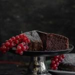 Eggless Chocolate Cake Recipe making and cke on a stand.