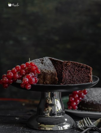 Eggless Chocolate Cake Recipe making and cke on a stand.