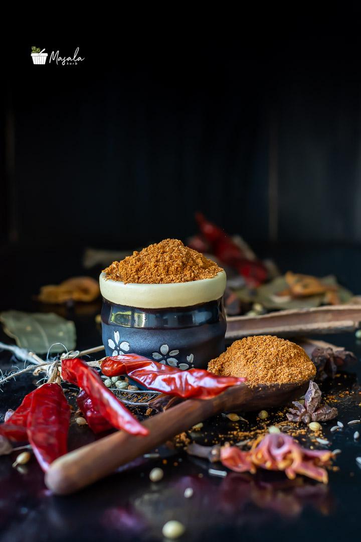 Homemade Pav bhaji masala powder with spices in frame.