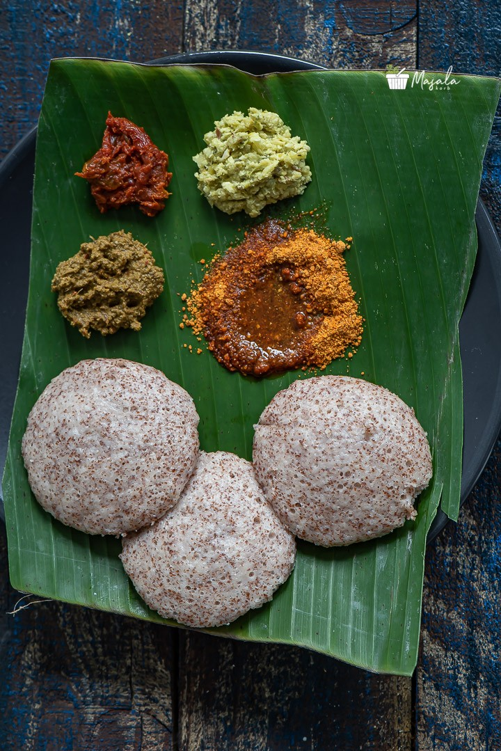 Ragi Idli served with an array of side dishes on a banana leaf