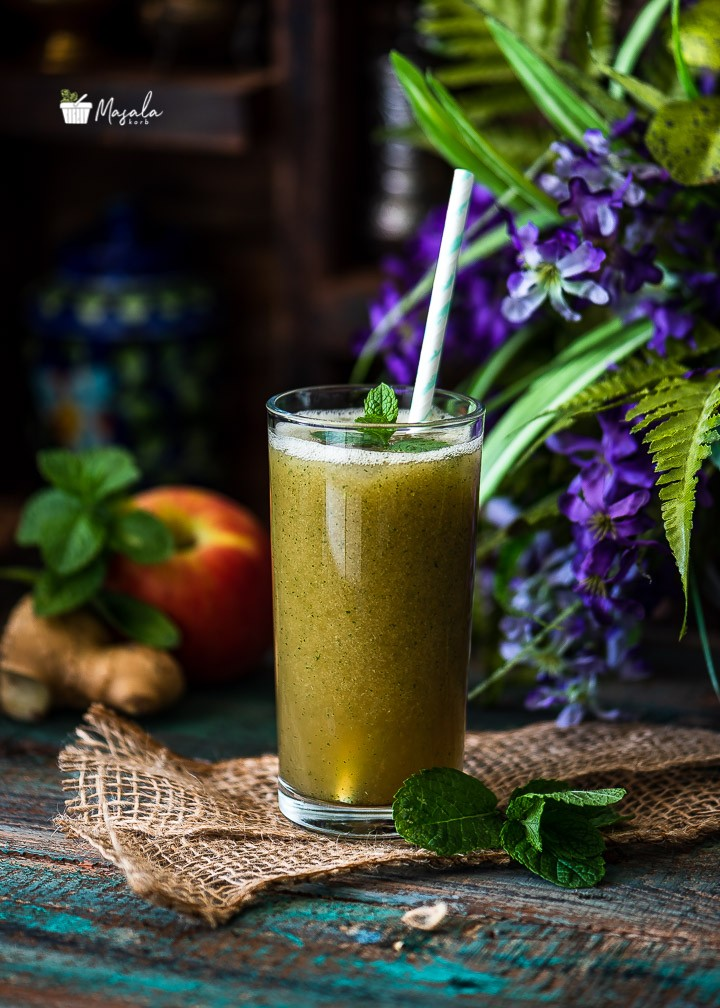 Apple Ginger Mint Juice served in a tall glass.