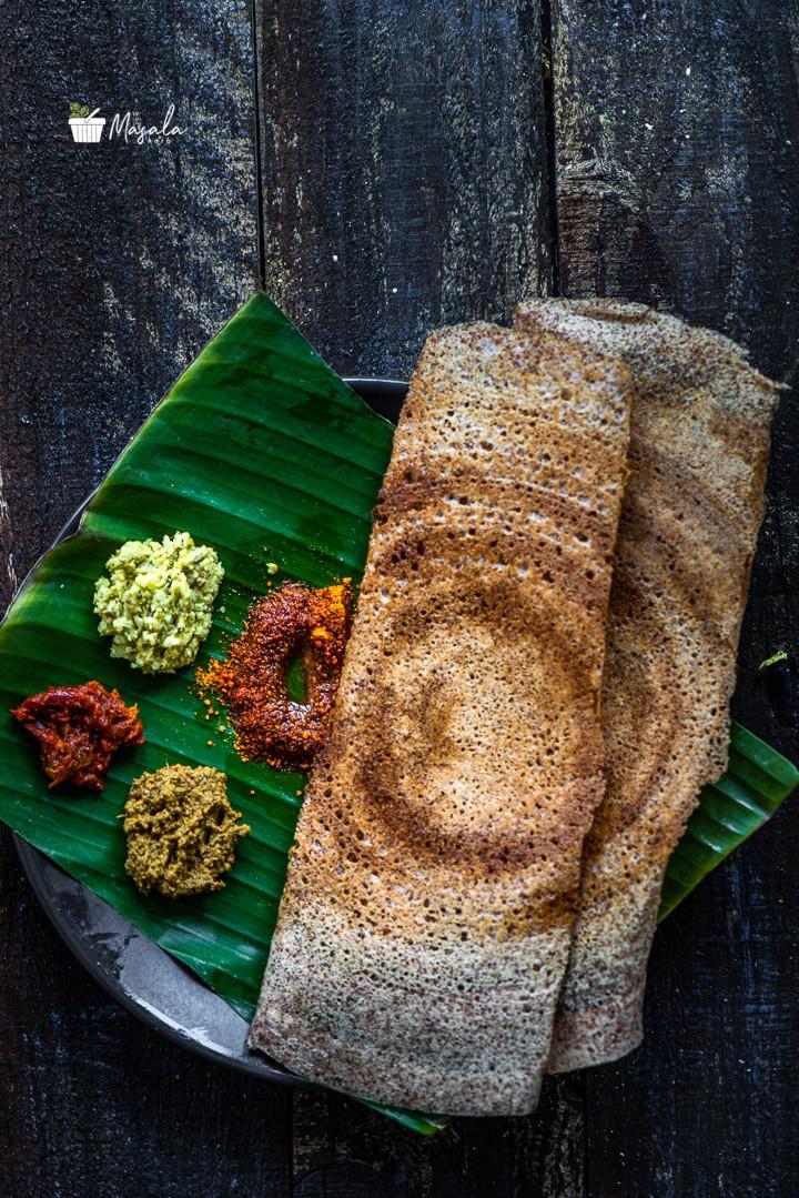 Crispy Ragi Dosa Recipe served on a banana leaf