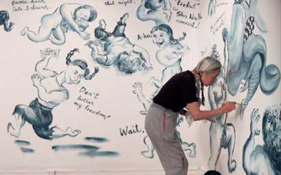 Noriko Shinohara working on a painting. From Zachary Heinzerling's CUTIE AND THE BOXER, a documentary about the 40-year marriage of artists Ushio and Noriko Shinohara. Photo credit: Zachary Heinzerling.