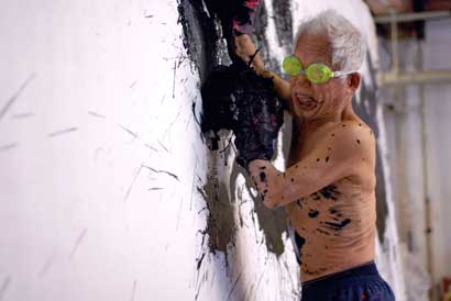 Ushio Shinohara working on a boxing painting. From Zachary Heinzerling's CUTIE AND THE BOXER, a documentary about the 40-year marriage of artists Ushio and Noriko Shinohara. Photo credit: Patrick Burns