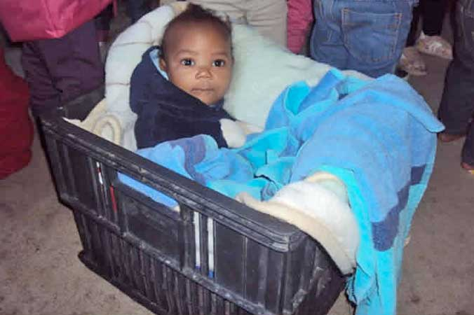 Before upgrade, lots of scope for creative thinking - the beer crate as cot