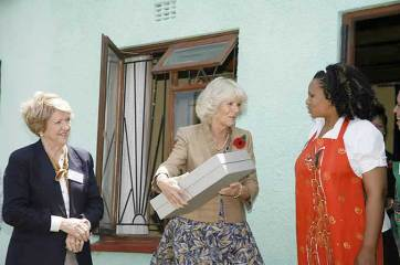 Camilla, Duchess of Cornwall, on her visit to Masiphumelele, accepts a gift from Nondyebo Arts - a Masicorp sponsored local business