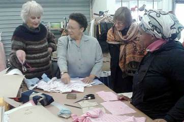 Dame Linda Dobbs, Masicorp's UK Patron meets members of the Sewing Club Lifeskills course