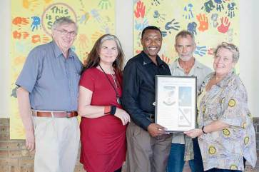 Viv Daubenspeck of Torquay Rotary Club accepts a 'thank you' from Ukhanyo School Principal Michael Thyali. With them, L-R- Andrew Smith, Fran Loudon and Paul Dibley