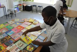 picture of child selecting from an assortment of books