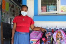 Teacher standing outside of her classroom.