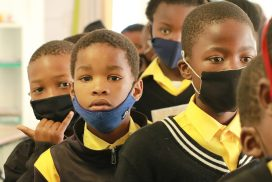 South African children lining up with masks on