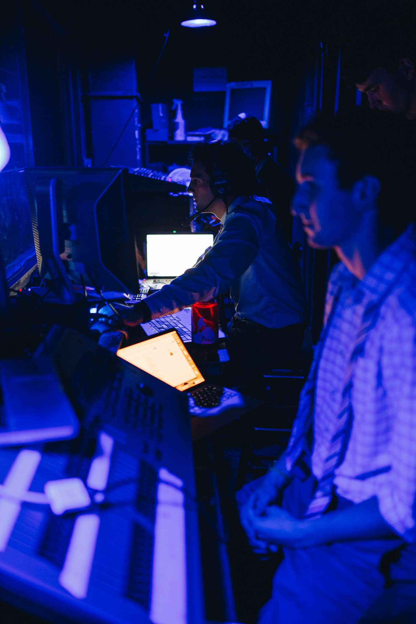 The stage crew works in the booth