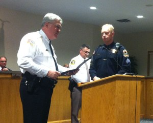 Ludington Police Sgt. Dave Maltbie receives a bravery citation from Chief Mark Barnett.  Mason County Sheriff Kim Cole is pictured in the background.