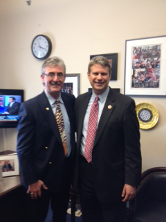 Squires, left, with Congressman Bill Huizenga.