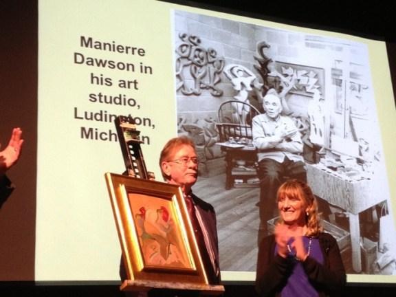 Dawson's grandson, Peter Lockwood, and Professor Emeritus Sharon Bluhm unveil the painting.